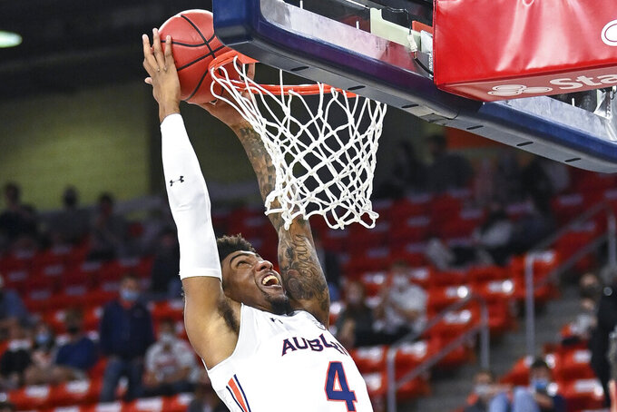 Auburn forward Javon Franklin dunks against Missouri during the first half of an NCAA college basketball game Tuesday, Jan. 26, 2021, in Auburn, Ala. (AP Photo/Julie Bennett)