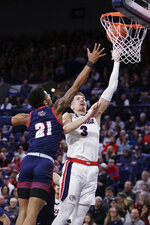 Gonzaga forward Filip Petrusev (3) shoots while pressured by Detroit Mercy forward Chris Brandon (21) during the first half of an NCAA college basketball game in Spokane, Wash., Monday, Dec. 30, 2019. (AP Photo/Young Kwak)