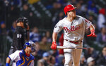 Philadelphia Phillies' J.T. Realmuto watches his solo home run against the Chicago Cubs during the 10th inning of a baseball game, Monday, May 20, 2019, in Chicago. (AP Photo/Kamil Krzaczynski)