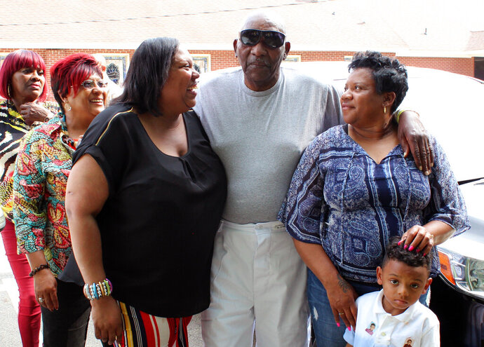 Surrounded by relatives, Charles Ray Finch leaves the Greene Correctional Institution, Thursday, May 23, 2019 in Maury, N.C. Finch, who served more than 40 years in prison for a shopkeeper's slaying in a failed robbery attempt is heading home. A federal judge in Raleigh ordered Finch's release earlier Thursday. In January, an appeals court ruled that evidence casts doubt on Finch's murder conviction. (Drew C. Wilson/The Wilson Times via AP)