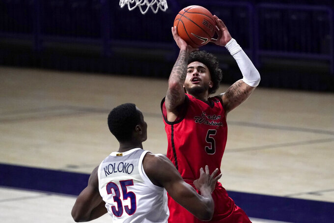 Eastern Washington guard Casson Rouse shoots over Arizona center Christian Koloko (35) during the second half of an NCAA college basketball game, Saturday, Dec. 5, 2020, in Tucson, Ariz.  (AP Photo/Rick Scuteri)
