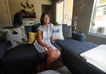 In this Monday, Aug. 12, 2019, photograph, Jennifer Mogensen talks about her adopted sister, Janelle Matthews, who went missing just before Christmas 1984 and whose remains were found recently in Greeley, Colo.   Mogensen called it a miracle that a construction crew found the remains of her sister last month. She says her family now hopes police can find the person responsible.  (AP Photo/David Zalubowski)
