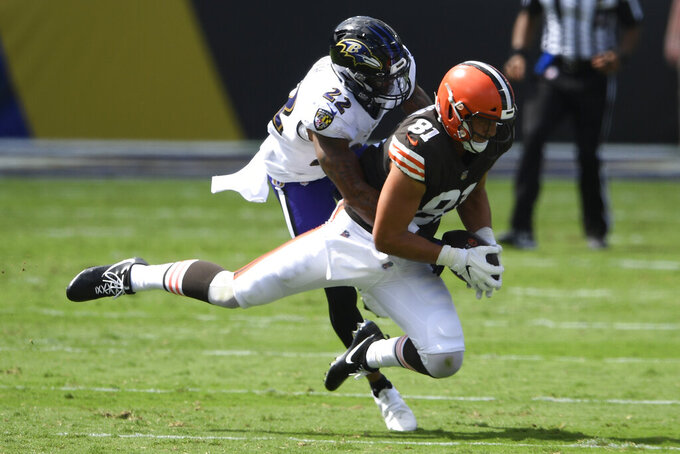 Baltimore Ravens cornerback Jimmy Smith (22) tackles Cleveland Browns tight end Austin Hooper (81), during the first half of an NFL football game, Sunday, Sept. 13, 2020, in Baltimore, MD. (AP Photo/Nick Wass)