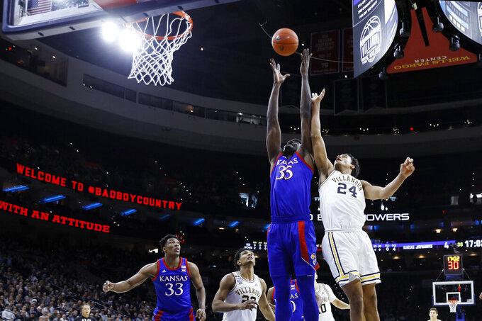 Kansas's Udoka Azubuike (35) goes up for a rebound against Villanova's Jeremiah Robinson-Earl (24) during the first half of an NCAA college basketball game, Saturday, Dec. 21, 2019, in Philadelphia. (AP Photo/Matt Slocum)