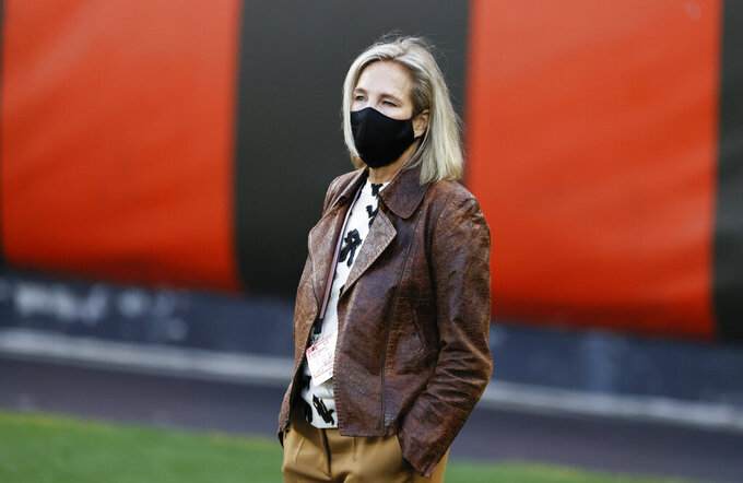 "FILE - In this Sept. 17, 2020, file photo, Cleveland Browns co-owner Dee Haslam walks the field before the team's NFL football game against the Cincinnati Bengals in Cleveland. ""We're seeing more and more women that love the sport and who want a career in sports,"" Haslam said last month. ""The door has swung wide open and I am so excited. I look forward to the moment when we don't have to talk about how we get the door open for women and people of color, that the door is wide open."" (AP Photo/Ron Schwane, File)"