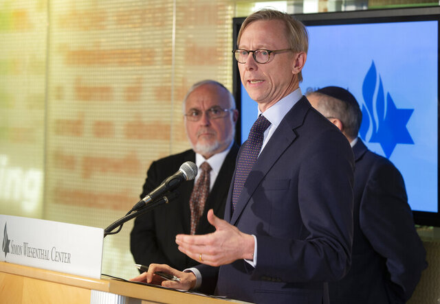 Brian Hook, a U.S. special representative on Iran, takes questions from the media at the Simon Wiesenthal Center in Los Angeles, Tuesday, Jan. 7, 2020. Hook briefed earlier Simon Wiesenthal Center leadership, national interfaith and local Iranian leaders in a closed door meeting on policy related to Iran. Rabbi Abraham Cooper Associate Dean, Director Global Social Action Agenda, left, and Rabbi Marvin Hier, founder, CEO and president of the Simon Wiesenthal Center, and its Museum of Tolerance. (AP Photo/Damian Dovarganes)