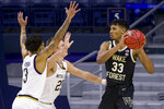 Wake Forest's Ody Oguama (33) gets pressure from Notre Dame's Prentiss Hubb (3) and Dane Goodwin (23) during the second half of an NCAA college basketball game Tuesday, Feb. 2, 2021, in South Bend, Ind. Notre Dame won 79-58. (AP Photo/Robert Franklin)