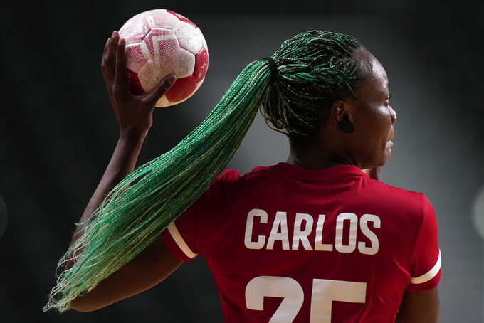 Angola's Azenaide Carlos controls the ball during the women's Preliminary Round Group A handball match between Netherlands and Angola at the 2020 Summer Olympics, Thursday, July 29, 2021, in Tokyo, Japan. (AP Photo/Pavel Golovkin)