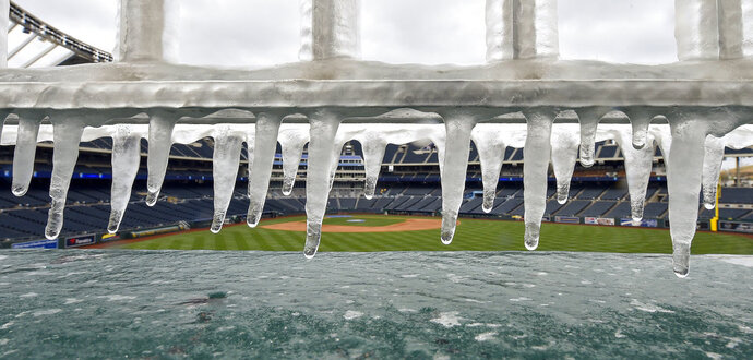 Ice forms on the railing above the fountains before a baseball game between the Kansas City Royals and Los Angeles Angels on Sunday, April 15, 2018, at Kauffman Stadium in Kansas City, Mo. (John Sleezer/The Kansas City Star via AP)