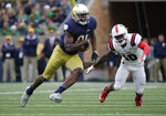 "FILE - In this Sept. 8, 2018, file photo, Notre Dame wide receiver Miles Boykin (81) runs with the ball against Ball State during the second half of an NCAA college football game in South Bend, Ind. Notre Dame won 24-16. Boykin is usually the tallest guy in a classroom at Notre Dame. The Irish offensive huddle is another matter. ""Once we had Chase (Claypool), Cole (Kmet), Alizé (Mack) and me, and I'm the smallest receiver out there on the field,"" said the 6-foot-4, 228-pound senior wideout, one of the shortest of six Notre Dame receivers and tight ends. Notre Dame plays Pittsburgh this week. (AP Photo/Nam Y. Huh, File)"