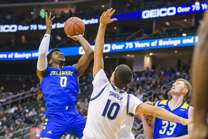 Villanova forward Cole Swider (10) defends Delaware guard Ryan Allen (0) as forward Collin Goss (33) looks on during the first half of the Never Forget Tribute Classic NCAA college basketball game, Saturday, Dec. 14, 2019, in Newark, N.J. (AP Photo/Corey Sipkin)