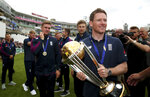 England's Eoin Morgan with the Trophy during celebrations marking their Cricket World Cup victory on Sunday over New Zealand, during at the Oval cricket ground in London Monday July 15, 2019.  (Steven Paston/PA via AP)