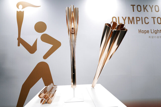 FILE -  In this March 20, 2019, file photo, Olympic torches of the Tokyo 2020 Olympic Games are displayed during a press conference in Tokyo. Members of the Japanese soccer team that won the Women's World Cup in 2011 will be the first to carry the torch for the Tokyo Olympics when the relay opens on March 26, 2020. Organizers made the announcement on Tuesday, Dec. 17, 2019 but did not say which player - or players - would be the first to carry the torch. (AP Photo/Eugene Hoshiko, File)