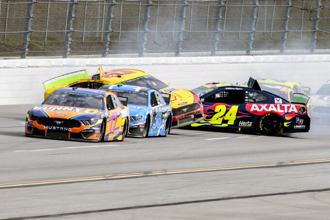 William Byron (24) hits into the side of Joey Logano (22) on the backstretch during a NASCAR Cup Series auto race at Talladega Superspeedway, Monday, Oct 14, 2019, in Talladega, Ala. (AP Photo/Greg McWilliams)