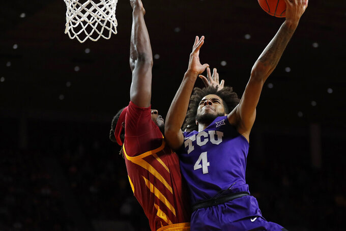 TCU guard PJ Fuller, right, puts up a shot against Iowa State forward Solomon Young during the second half of an NCAA college basketball game, Tuesday, Feb. 25, 2020, in Ames, Iowa. Iowa State won 65-59. (AP Photo/Matthew Putney)