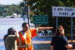 People try to reach the other side of 206 route partially flooded  as a result of the remnants of Hurricane Ida in Somerville, NJ., Thursday, Sept. 2, 2021. (AP Photo/Eduardo Munoz Alvarez)
