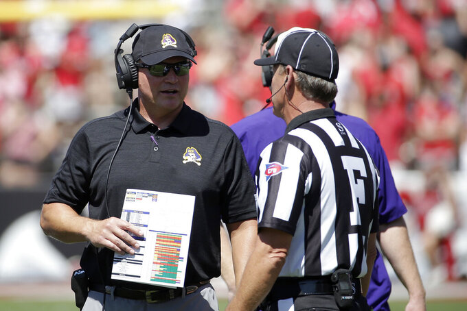 East Carolina head coach Mike Houston speaks with an official during the first half of an NCAA college football game against North Carolina State in Raleigh, N.C., Saturday, Aug. 31, 2019. (AP Photo/Gerry Broome)