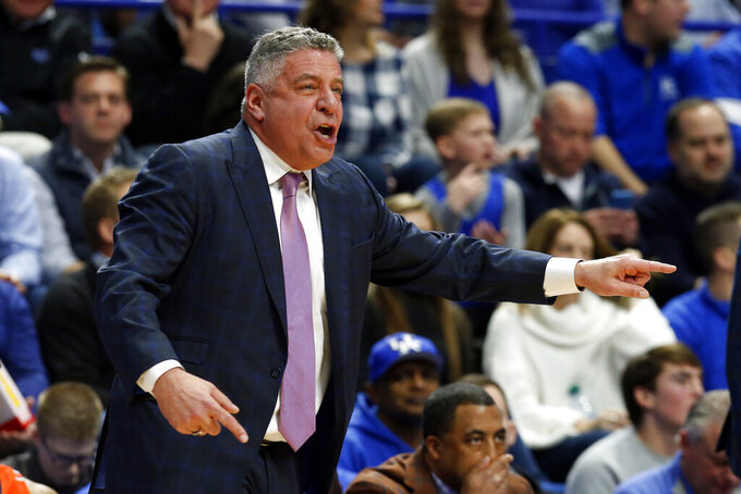 Auburn head coach Bruce Pearl directs his team during the first half of an NCAA college basketball game against Kentucky in Lexington, Ky., Saturday, Feb. 29, 2020. (AP Photo/James Crisp)