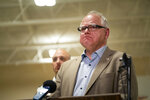 Gov. Tim Walz speaks during a news conference, Thursday, Dec. 5, 2019 in Marty, Minn. A Black Hawk helicopter with three crew members aboard crashed Thursday in central Minnesota, the Minnesota National Guard said, though officials did not offer any immediate information about the conditions of crew members. (Renee Jones Schneider/Star Tribune via AP)