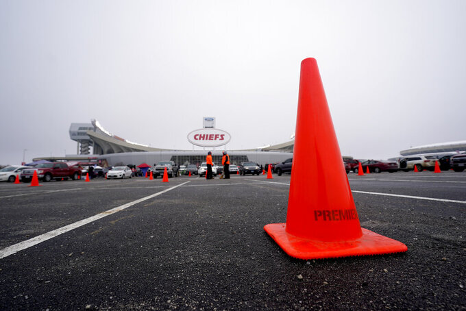 Cones mark the parking lot outside Arrowhead Stadium to promote social distancing to help prevent the spread of COVID-19 before an NFL football game between the Los Angeles Chargers and the Kansas City Chiefs Sunday, Jan. 3, 2021, in Kansas City, Mo. (AP Photo/Charlie Riedel)