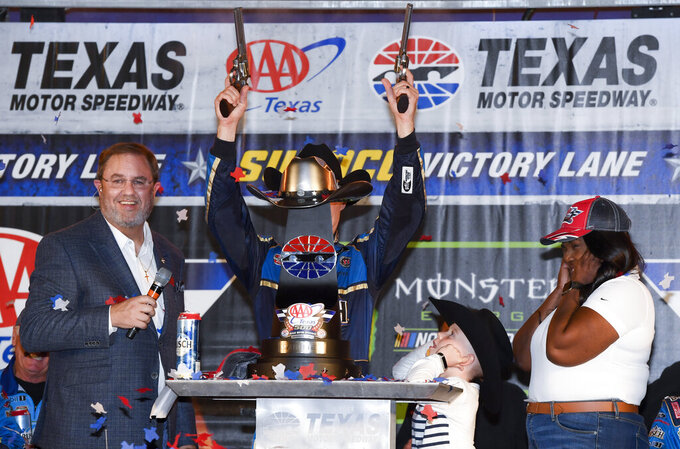 Kevin Harvick, obscured, celebrates in Victory Lane after winning a NASCAR Cup Series auto race at Texas Motor Speedway, Sunday, Nov. 3, 2019, in Fort Worth, Texas. (AP Photo/Larry Papke)