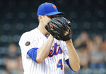 New York Mets starterJacob deGrom waits for a sign before delivering a pitch during the first inning of the team's baseball game against the Philadelphia Phillies on Wednesday, July 11, 2018, in New York. (AP Photo/Frank Franklin II)