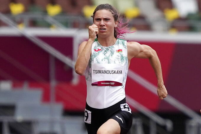 Krystsina Tsimanouskaya, of Belarus, runs in the women's 100-meter run at the 2020 Summer Olympics, Friday, July 30, 2021. Tsimanouskaya alleged her Olympic team tried to remove her from Japan in a dispute that led to a standoff Sunday, Aug. 1, at Tokyo's main airport. An activist group supporting Tsimanouskaya said she believed her life was in danger in Belarus and would seek asylum with the Austrian embassy in Tokyo. (AP Photo/Martin Meissner)