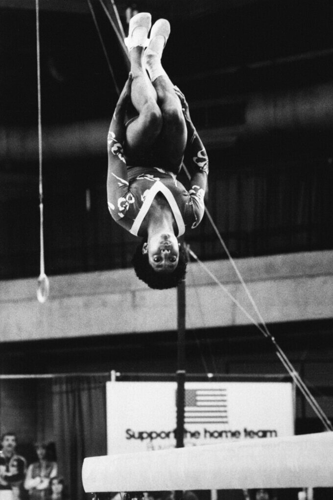 FIlE - In this June 6, 1983, file photo, Dianne Durham, of Gary, Ind., does a flip during individual final competition of the balance beam in Chicago at the McDonald's Gymnastic Championships of the U.S.A. Durham, the first Black woman to win a USA Gymnastics national championship, died on Thursday, Feb. 4, 2021, She was 52. (AP Photo/Lisa Genesen, File)