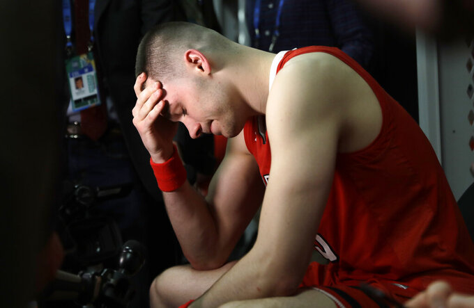 Texas Tech's Matt Mooney reacts in the locker room after the team's 85-77 loss to Virginia in the overtime in the championship of the Final Four NCAA college basketball tournament, Monday, April 8, 2019, in Minneapolis. (AP Photo/Jeff Roberson)