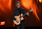 """FILE - Alejandro Sanz performs """"Mala Gente"""" at the Latin Recording Academy Person of the Year gala honoring Juanes on Nov. 13, 2019, in Las Vegas. Sanz performed """"Imagine"""" by John Lennon and Yoko Ono, with John Legend, Keith Urban and Angelique Kidjo via pre-recorded video at the opening ceremony of the Tokyo Olympics on July 23, 2021. (Photo by Chris Pizzello/Invision/AP, File)"""