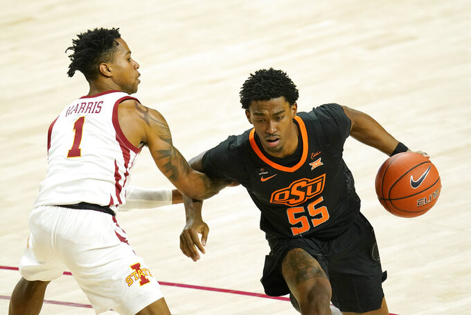 Oklahoma State guard Dee Mitchell (55) drives past Iowa State guard Tyler Harris (1) during the second half of an NCAA college basketball game, Monday, Jan. 25, 2021, in Ames, Iowa. Oklahoma State won 81-60. (AP Photo/Charlie Neibergall)