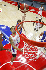 Angel Rodriguez of Puerto Rico goes for a shot during their Group J second phase match against Italy for the FIBA Basketball World Cup, at the Wuhan Sports Center in Wuhan in central China's Hubei province, Sunday, Sept. 8, 2019. (AP Photo/Andy Wong, Pool)