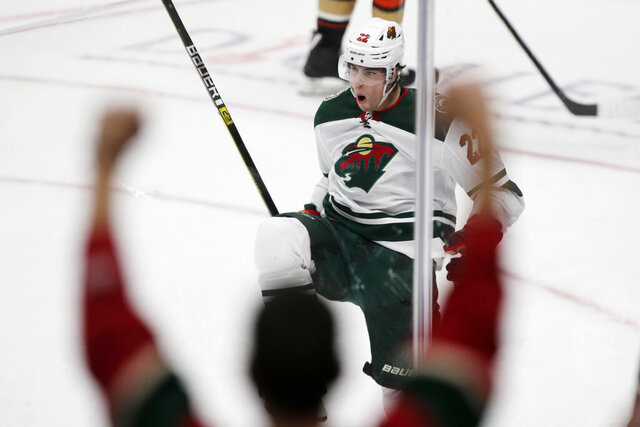 Minnesota Wild left wing Kevin Fiala, of Switzerland, reacts after scoring against the Anaheim Ducks during the overtime period of an NHL hockey game in Anaheim, Calif., Sunday, March 8, 2020. (AP Photo/Alex Gallardo)