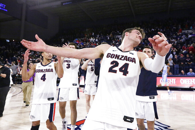 Gonzaga forward Corey Kispert (24) celebrates after his team won an NCAA college basketball game against North Carolina 94-81, in Spokane, Wash., Wednesday, Dec. 18, 2019.(AP Photo/Young Kwak)