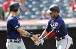 Minnesota Twins' Jorge Polanco, right, is congratulated by Max Kepler after Polanco hit a two-run home run in the third inning in the first baseball game of a baseball doubleheader against the Cleveland Indians, Saturday, Sept. 14, 2019, in Cleveland. (AP Photo/Tony Dejak)