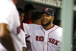 Boston Red Sox starting pitcher Eduardo Rodriguez (57) smiles in the dugout after pitching through the seventh inning of the team's baseball game against the Minnesota Twins, Wednesday, Sept. 4, 2019, in Boston. (AP Photo/Mary Schwalm)