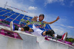 Heimana Reynolds of the United States takes part in a men's park skateboarding practice session at the 2020 Summer Olympics, Monday, Aug. 2, 2021, in Tokyo, Japan. (AP Photo/Ben Curtis)