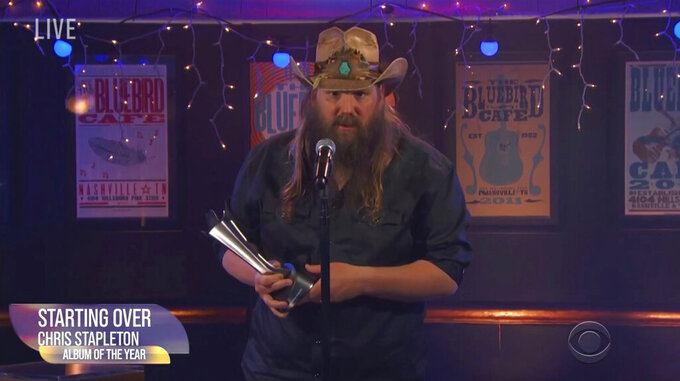 """In this video grab provided by CBS, Chris Stapleton accepts the award for album of the year for """"Starting Over"""" during the 56th annual Academy of Country Music Awards on Sunday, April 18, 2021, at the Bluebird Cafe in Nashville, Tenn. (CBS via AP)"""