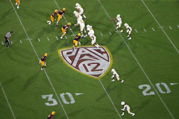 FILE - This Thursday, Aug. 29, 2019, file photo, shows the Pac-12 logo during the second half of an NCAA college football game between Arizona State and Kent State, in Tempe, Ariz. The Pac-12 has become the second major conference to shift to a conference-only fall schedule amid growing concerns over the coronavirus pandemic. (AP Photo/Ralph Freso, File)