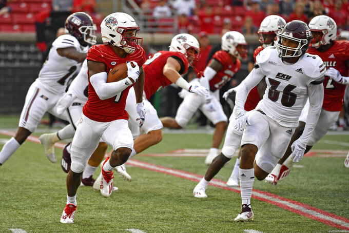 Louisville's Braden Smith (4) is pursued by Eastern Kentucky's Kyle Bailey (36) during the first half of an NCAA college football game in Louisville, Ky., Saturday, Sept. 11, 2021. (AP Photo/Timothy D. Easley)