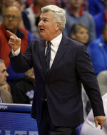 Kansas State head coach Bruce Weber points to an official during the first half of an NCAA college basketball game against Kansas in Lawrence, Kan., Monday, Feb. 25, 2019. (AP Photo/Orlin Wagner)
