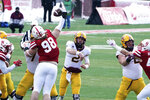 Nebraska defensive lineman Casey Rogers (98) blocks a pass by Minnesota quarterback Tanner Morgan (2) during the first half of an NCAA college football game in Lincoln, Neb., Saturday, Dec. 12, 2020. (AP Photo/Nati Harnik)