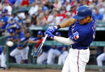 Texas Rangers'Shin-Soo Choo connects for a run-scoring double off a pitch from Cleveland Indians starting pitcher Mike Clevinger in the third inning of a baseball game in Arlington, Texas, Monday, June 17, 2019. The hit scored Ronald Guzman. (AP Photo/Tony Gutierrez)