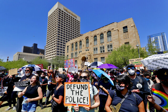 Protesters rally Wednesday, June 3, 2020, in Phoenix, demanding that the Phoenix City Council defund the Phoenix Police Department. The protest is a result of the death of George Floyd, a black man who died after being restrained by Minneapolis police officers on May 25. (AP Photo/Matt York)
