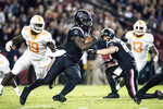 South Carolina wide receiver Deebo Samuel, center, runs with the ball against Tennessee linebacker Darrell Taylor (19) during the first half of an NCAA college football game against Tennessee Saturday, Oct. 27, 2018, in Columbia, S.C. (AP Photo/Sean Rayford)