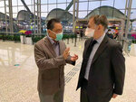 In this Jan. 29, 2020, photo provided by Ian Lipkin, Lipkin, right, director of the Center for Infection and Immunity at Columbia University, meets with Zhong Nanshan at the Guangzhou airport in Guangzhou, China. Both were advisers to the Chinese government during the SARS outbreak and will be working together again for COVID-19. Lipkin is under a quarantine since his return from China, monitoring for possible symptoms of coronavirus. (Guo Cheng/Courtesy of Ian Lipkin via AP)