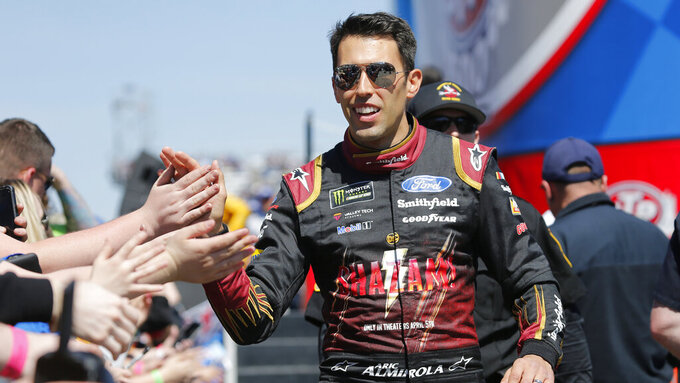 NASCAR Cup Series driver Aric Almirola (10) greets fans during driver introductions prior to the NASCAR Cup Series auto race at the Martinsville Speedway in Martinsville, Va., Sunday, March 24, 2019. (AP Photo/Steve Helber)