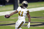 New Orleans Saints running back Alvin Kamara (41) crosses the goal line on a touchdown carry in the first half of an NFL football game against the Minnesota Vikings in New Orleans, Friday, Dec. 25, 2020. (AP Photo/Brett Duke)
