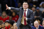 Indiana coach Archie Miller directs his team during the first half of an NCAA college basketball game against Iowa, Friday, Feb. 22, 2019, in Iowa City, Iowa. (AP Photo/Charlie Neibergall)