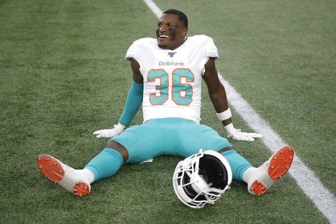 Miami Dolphins safety Adrian Colbert celebrates after the Dolphins defeated the New England Patriots in an NFL football game, Sunday, Dec. 29, 2019, in Foxborough, Mass. (AP Photo/Elise Amendola)